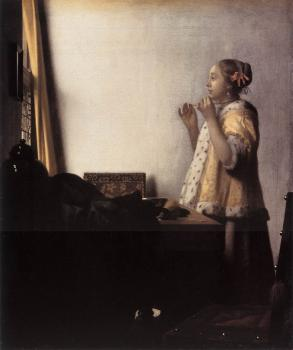 Johannes Vermeer : Woman with a Pearl Necklace